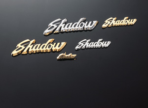 EMBLEM SHADOW M ADHESIVE GOLD